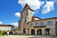 Fortified church in Royal square of Labastide d Armagnac. Fortified church and city Hall building in Royal square of Labastide d Armagnac, in the center of Stock Images