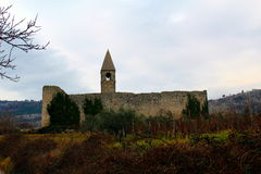 Fortified church in Slovenia. Fortified medieval church surrounded by walls Stock Photo