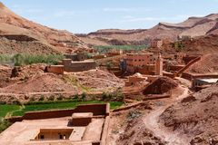 Fortified city of Tinghir along the former caravan route between the Sahara and Marrakech in Morocco with snow covered Atlas royalty free stock photography