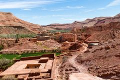 Fortified city of Tinghir along the former caravan route between the Sahara and Marrakech in Morocco with snow covered Atlas royalty free stock image