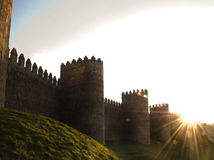 Fortified City Walls, Avila Spain. Iconic fortified city walls, this is Avila in the Castille y Leon region. At sunset with strong sunburst Royalty Free Stock Photos