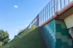 Sound absorbing screens on the highway and overpass,colored concrete pillars. The fortified earthen slope of the rampart.Modern technology , Poland stock photo