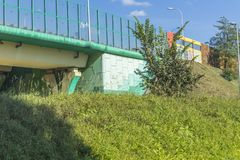Sound absorbing screens on the highway and overpass,colored concrete pillars. The fortified earthen slope of the rampart.Modern technology , Poland royalty free stock photo