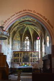 Fortified medieval saxon church in the village Malancrav, Transylvania. Here some of the most significant Gothic murals in Transylvania. The Saxon Romanesque Royalty Free Stock Photo