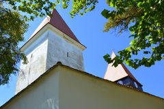 Fortified medieval saxon church in the village Merghindeal- Mergenthal, Transylvania, Romania Royalty Free Stock Image
