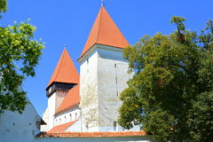 Fortified medieval saxon church in the village Merghindeal- Mergenthal, Transylvania,Romania Stock Images
