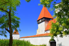 Fortified medieval saxon church in the village Merghindeal- Mergenthal, Transylvania, Romania Royalty Free Stock Photo