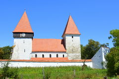 Fortified medieval saxon church in the village Merghindeal- Mergenthal, Transylvania, Romania Stock Image