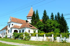 Fortified medieval saxon evangelic church in the village Somartin, Martinsberg, Märtelsberg, Transylvania, Romania. Peasant houses. Somartin, is a commune Royalty Free Stock Image