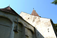 Fortified medieval saxon evangelic church in the village Somartin, Martinsberg, Märtelsberg, Transylvania, Romania. Village Somartin, Martinsberg, Mä stock photography