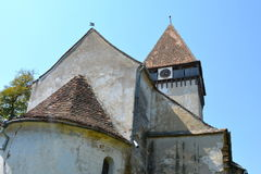Fortified medieval saxon evangelic church in the village Toarcla, Tartlau, Transylvania, Romania. The village Toarcla, Tartlau, Transylvania, Romania. The Stock Photography