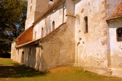 Fortified medieval saxon evangelic church in the village Toarcla, Tartlau, Transylvania, Romania. The village Toarcla, Tartlau, Transylvania, Romania. The Royalty Free Stock Image