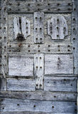 Fortified medieval wooden door with hardware elements Royalty Free Stock Photography