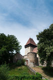 Fortified temple. Medieval fortified temple in Ighisul Nou(Eibesdorf), Romania Stock Photo