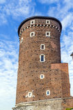 Fortified tower of the Gothic Wawel Castle in Kraków in Poland. Fortified tower of the Wawel castle on a sunny day with blue sky and white clouds, Krakow royalty free stock image