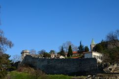 Fortified wall church and tower of Belgrade Fortress Serbia. Belgrade, Serbia - March 20, 2015: A view looking up the hill on which the historic Belgrade Royalty Free Stock Photo