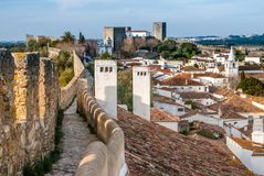 Fortified wall in Obidos, Portugal. A view of the fortified wall in Obidos, Portugal. The name Obidos probably derives from the Latin term oppidum, meaning Stock Photo