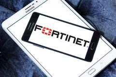 Fortinet company logo. Logo of Fortinet company on samsung mobile. Fortinet is an American multinational corporation. It develops and markets cybersecurity Royalty Free Stock Image