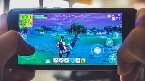 Fortnite gameplay battle royale game smartphone. Fortnite gameplay - the battle royale game on smartphone in Bologna, Italy,  19 March 2019 stock image