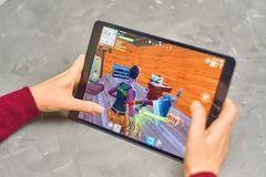 Fortnite Gameplay on ipad. Bishkek, Kyrgyzstan - January 21, 2019: Woman playing fortnite game of epic games company on Apple ios tablet iPad Pro royalty free stock images