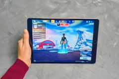 Fortnite Gameplay on ipad. Bishkek, Kyrgyzstan - January 21, 2019: Woman playing fortnite game of epic games company on Apple ios tablet iPad Pro royalty free stock photo