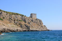 Fortress. Ancient fortress overlooking the blue sea, majestically overlooking the mediterranean sea from above Royalty Free Stock Images
