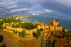 Fortress. Fantastic fortress on a background of a modern city. Digital artwork Stock Photos