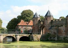 Fortress in Amersfoort. Part of the Koppelpoort from 1425 in Amersfoort, a town gate consisting of a land and a water gate. At this place the river Eem is Stock Image