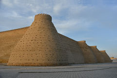Fortress Ark of Bukhara. The Ark is a massive fortress located in the city of Bukhara, Uzbekistan. The castle is situated against the blue sky background Royalty Free Stock Images