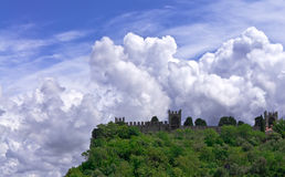 Fortress on a background cloudy sky Stock Image