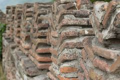 Fortress battlements from scorched bricks stock photo