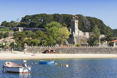 Fortress and beach in Bayonne. Pontevedra. Galicia. Beach and ancient fortress to defend the Galician coast Stock Image