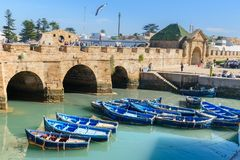 Fortress and blue fishing boats in Essaouira. Morocco Stock Images