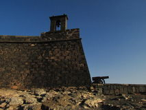 Fortress with cannon. And bell tower in Lanzarote Island royalty free stock photo