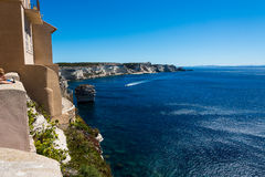 The fortress in cliff Bonifacio. Bonifacio fortress in cliff with many stairs. Landscape of sea stock photography