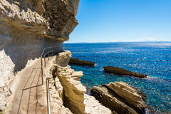 The fortress in cliff Bonifacio. Bonifacio fortress in cliff with many stairs. Landscape of sea stock images