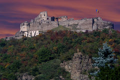 Fortress of the Deva in dusk. Fortress of the Deva dates from the year 1269. Today Deva Fortress is a wreck, following an explosion in the year 1849 products in royalty free illustration