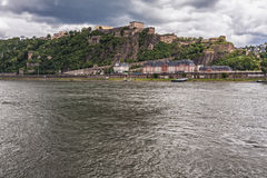Fortress Ehrenbreitstein on cloudy day on the side of river stock image