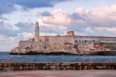 The fortress of El Morro in Havana at sunset. The old fortress of El Morro in Havana at sunset Royalty Free Stock Image