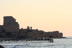 Fortress,fishemen and sea. Sunset on mediterranean sea in Israel Royalty Free Stock Photos