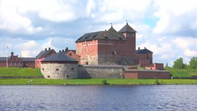 The fortress of Hameenlinna on lake Vanajavesi, sunny june day. Finland stock footage