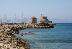 Fortress and lighthouse at Rhodes island Stock Images