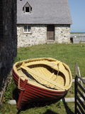 Fortress Louisbourg old boat and stone building Royalty Free Stock Photo