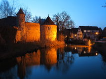 Fortress with moat at night Royalty Free Stock Images