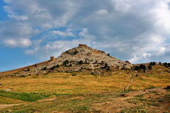 Fortress on mountain under cloud. Landscape, fortress on mountain under cloud Royalty Free Stock Photo