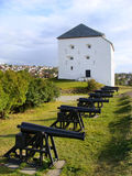Fortress in Norway. The historic, Kristiansten fortress guarded by a row of cannons in Trondheim, Norway Stock Photo