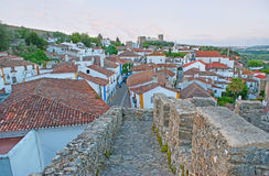 The fortress of Obidos. The fortress wall of Obidos overlooks the old tile roofs of the town, its twisted streets and Castle on background, Portugal Royalty Free Stock Image