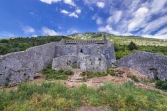 Fortress in Perast. Walls of Fort of St Corss in Perast, old coastal town in Kotor Bay, Montenegro Stock Photos