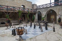 Fortress of Rakvere. Inner courtyard with large chess in the medieval fortress of Rakvere, Estonia, July 5, 2018 stock photography