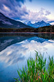 The Fortress reflected in the waters of Wedge Pond, Kananaskis, Royalty Free Stock Photography